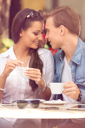 shop tender: young loving couple having romantic dating at cafe Stock Photo