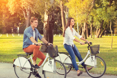 affectionate actions: young couple on bicycles, leisure recreation