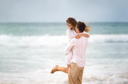 Happiness couple on beach,  having fun