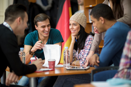 happy teenagers: Teamwork joking and studying for college exam Stock Photo
