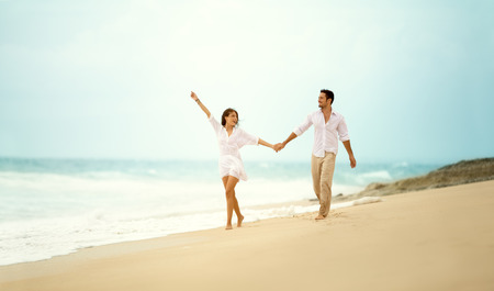 laughing couple in love holding hand enjoying in summertime