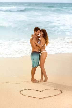 love hearts: Young attractive and beautiful couple in love,  romantic summer holidays