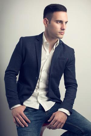 young man portrait: Elegant young handsome man. Studio fashion portrait.