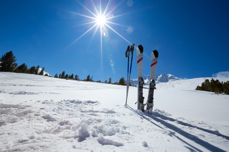 a slope: Pair of cross skis in snow, skiing, winter season