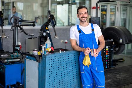 auto repair: Satisfied male engineer in an auto repair shop
