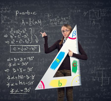 theorem: female student with a big ruler pointing at  Pythagorean theorem on blackboard Stock Photo