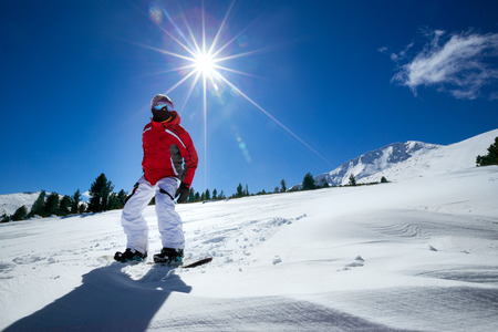 lifestyle outdoors: Sport man in snow mountains in background beautiful sky