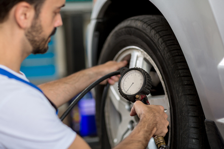 tire: check holding pressure gauge for car tyre pressure measurement Stock Photo