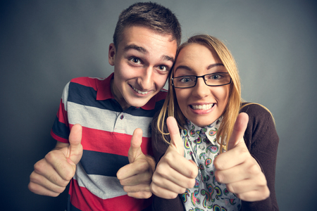 nerdy: Happy nerdy couple showing thumbs up Stock Photo