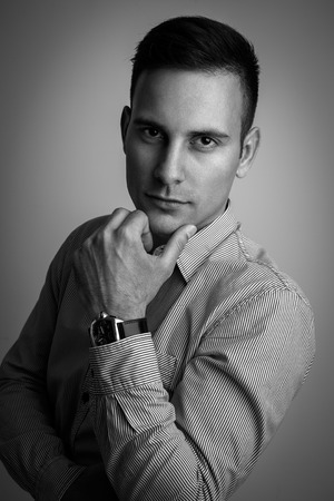 male models: Fashion portrait of young man, white and black