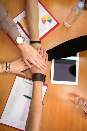 team hands: Multiethnic hands together team unity concept Stock Photo