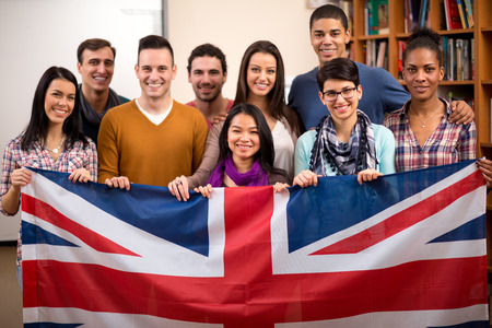 Group of British students presents their country and hold the flag Stock Photo