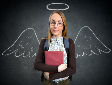 preoccupation: schoolgirl with funny angel wings and nimbus