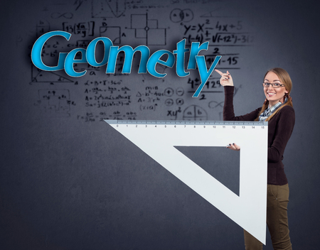 ruler: Student girl pointing at word geometry and holding big triangle ruler