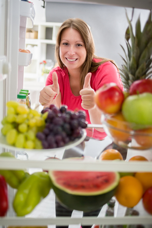 healthy looking: Good looking woman show thumb up for healthy food, fruit and vegetables
