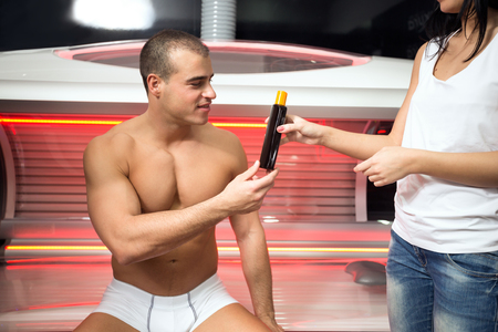 lux: man receives instruction in the solarium of employed women Stock Photo