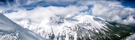 snow covered mountain: Winter mountain panorama with snowy trees on slope on resort Bansko, Bulgaria Stock Photo