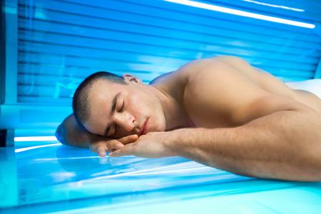 solarium: Young men enjoying in solarium