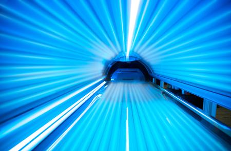 Empty tanning bed solarium Foto de archivo