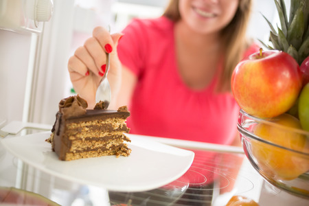 attracts: Lovely piece of chocolate cake attracts girl to take it