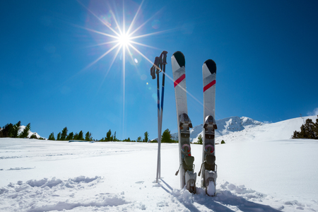 Skiing, winter season , mountains and ski equipment on ski run