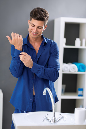 hurried: Young businessman in bathroom preparing for work