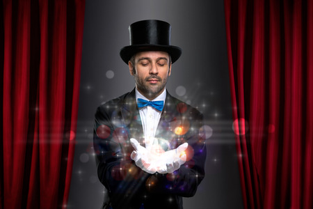 conjuror: magician holding magic on palm of his hand