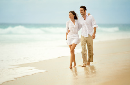 romantic beach: loving couple enjoying seascape, active lifestyle, romantic feelings, honeymoon on luxury beach resort, summer vacation concept Stock Photo