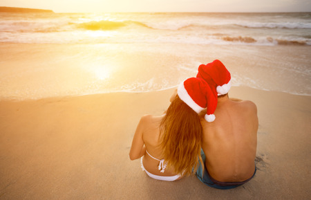 christmas hat: Young couple having romantic Christmas vacation