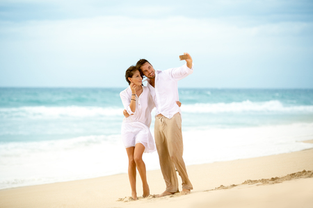 portrait couple: Romantic couple on the beach and taking a selfie