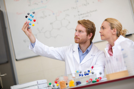 molecular model: Chemists in classroom show molecular model and studying with his assistant