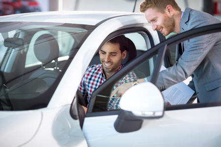 kindly: car manager kindly show car customer Stock Photo