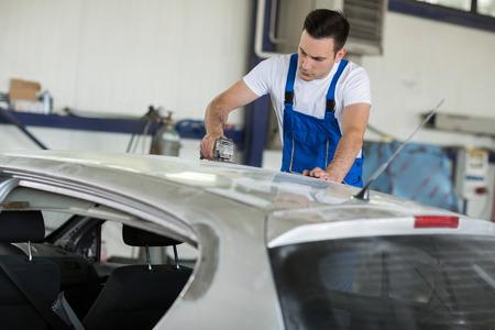 Car painter fixing damage on car