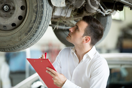 Inspector expert inspection damage on car Stock Photo
