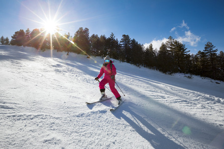 bulgaria girl: Young girl on skis at mountains in winter