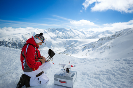 remote controls: Expert male engineer with remote controls quadrocopter drone a the mountains
