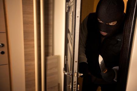 burglar protection: Danger burglar breaks into a apartment