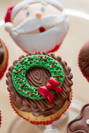 christmas symbol: decorative Christmas cupcake wit green-red symbol on top
