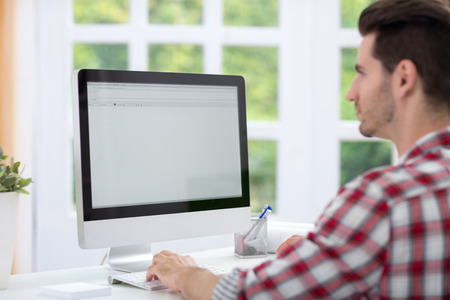 man working computer: Man sitting front of  computer and working