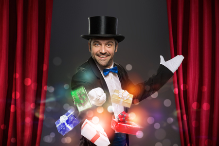 performs: Cheerful magician performs the trick with magic box