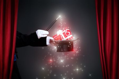 conjuror: Magician hand with magic wand making Christmas  gift, Christmas spell
