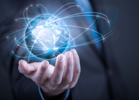world of work: Businessman holding planet Earth in palm.  Stock Photo
