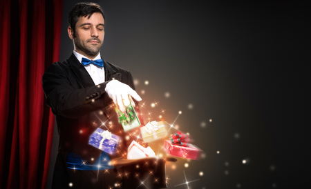 magician with magic Christmas  box,  performs the trick