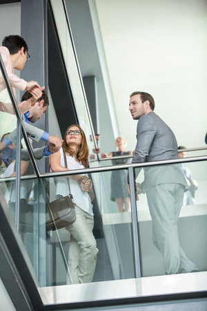 businesspeople: young business people have meeting in corridor