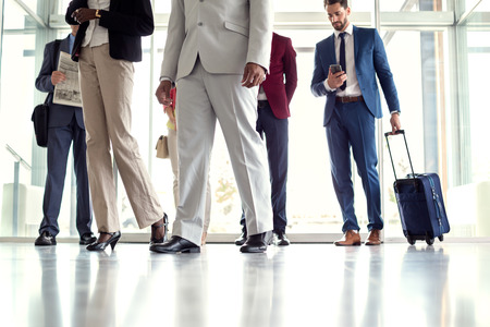 mixed age: Close up of businessmen at airport