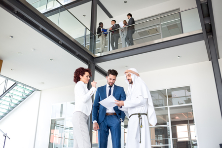 mixed age: Successful business arrangement with middle east Arabian businessman Stock Photo