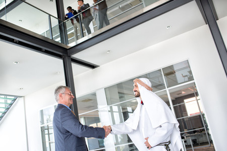 receive: Director of global company receive Arabian businessman Stock Photo