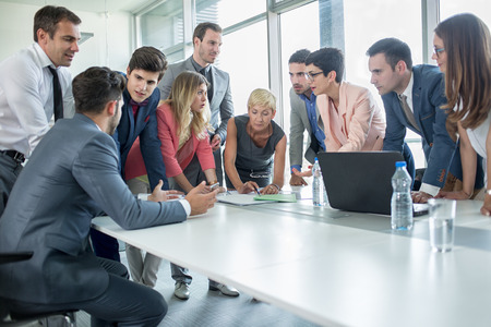 people working together: successful corporate people having a business meeting in office Stock Photo