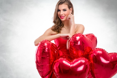 anniversary sexy: Valentines, romantic woman with red heart balloons