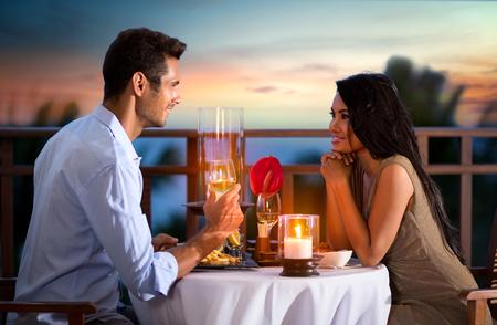 asia nude: Happy couple on summer evening having romantic dinner outdoor